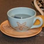 A beautiful beach-themed mug and saucer combo.